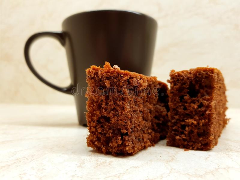 Coffee and dessert. On the kitchen, two pieces of brown gingerbread stock images