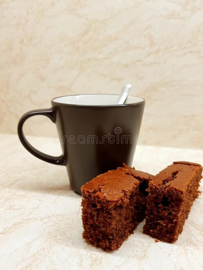 Coffee and dessert. On the kitchen, two pieces of brown gingerbread royalty free stock photos