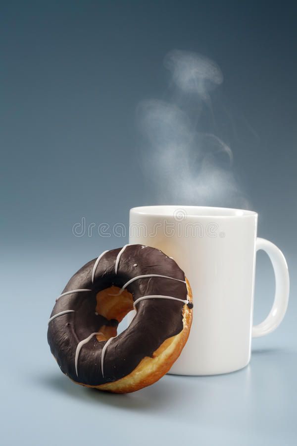 Coffee and donut stock images