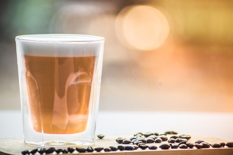Coffee in Drinking Glass With Black Beans royalty free stock photo