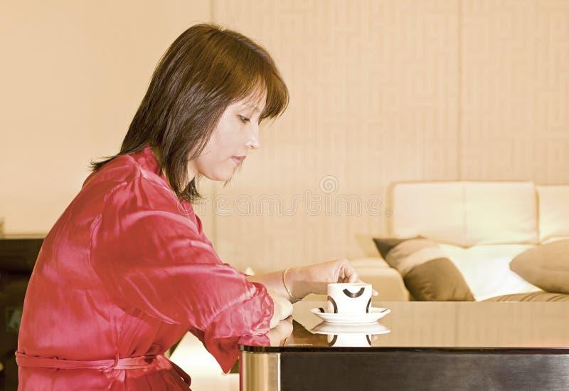A coffee drinking woman stock photo