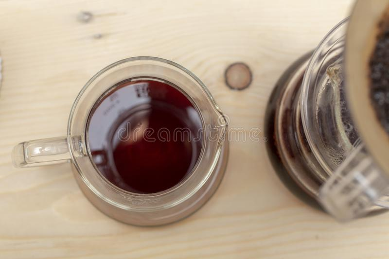 Coffee drip from steaming filter drip style on the table stock photos