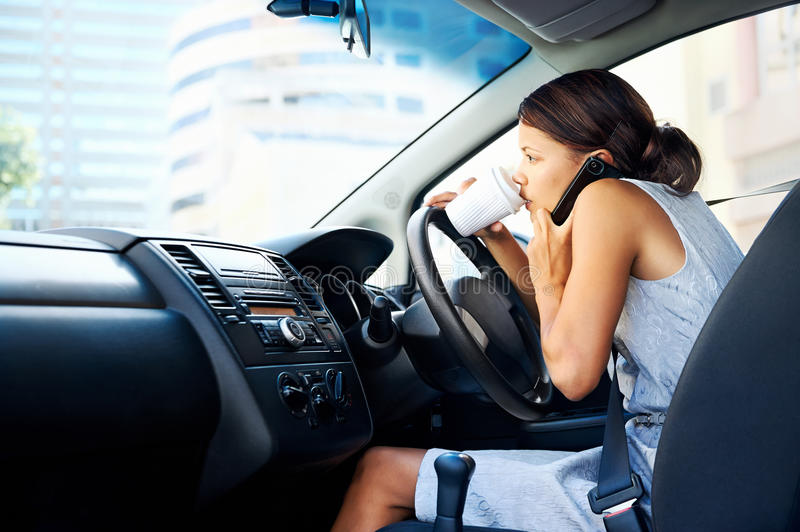 Coffee driving woman stock photo