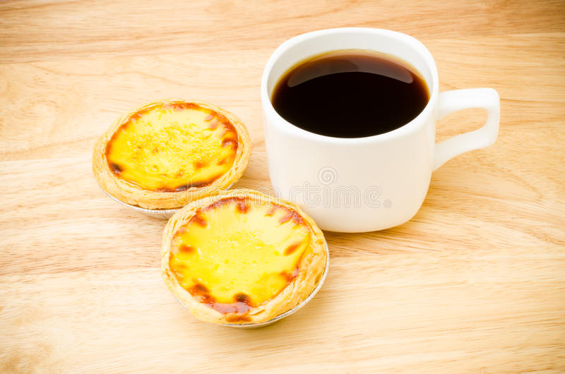 Coffee and egg tart. On wooden background,breakfast stock photos