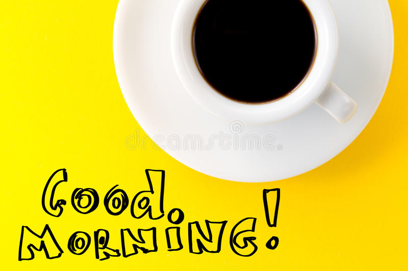 Coffee espresso in small white ceramic cup on yellow vibrant background. Text Good Morning. Minimalism Food Morning Energy stock photos