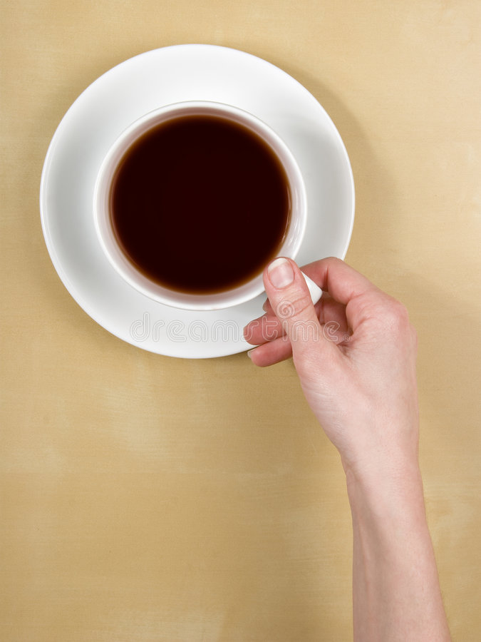 Download Coffee -female Hand Holds A Cup Of Tea On Table Stock Photo - Image: 8263028