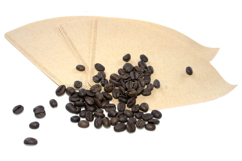 Coffee filters and beans royalty free stock photo