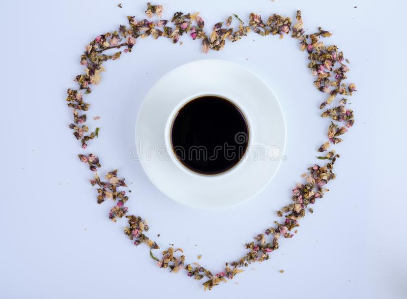 A cup of Black coffee and flowers with white background royalty free stock photo