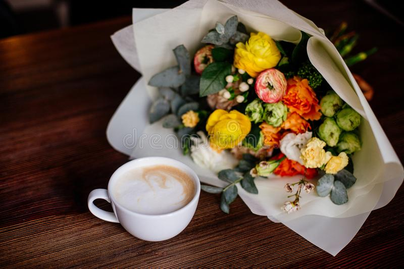 Coffee and flowers bouquet.n stock photo
