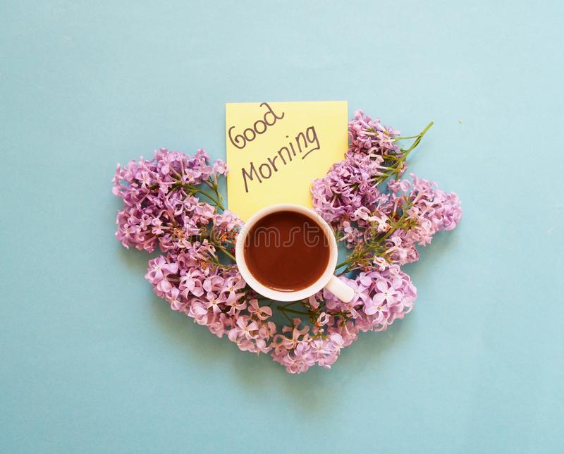 Coffee and flowers. Good morning note with coffee and lilac royalty free stock images