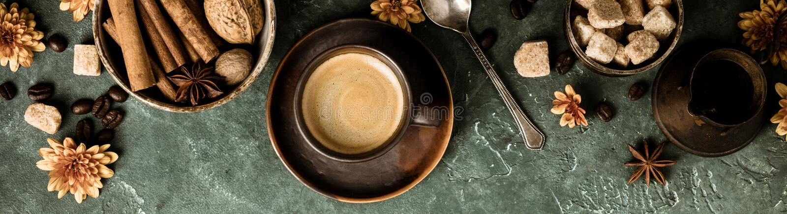 Coffee, flowers and spices on old green background royalty free stock photo