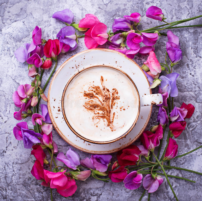 Coffee and flowers. Top view stock image