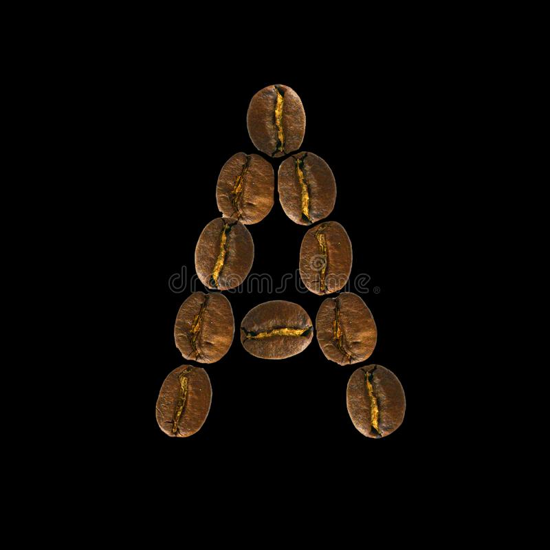 Coffee font alphabet concept isolated on white background. Top view Alphabet made of roasted coffee beans. Letter A royalty free stock photography