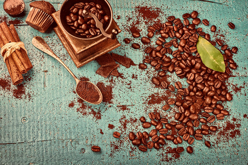 Coffee frame with roasted coffee beans, cinnamon sticks, old woo stock photos