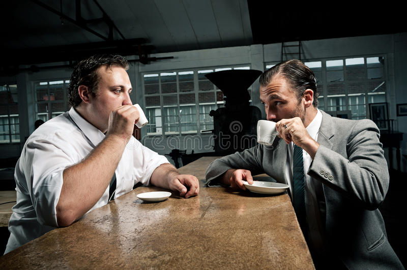 Coffee Friends Sip Their Expresso Royalty Free Stock Photos