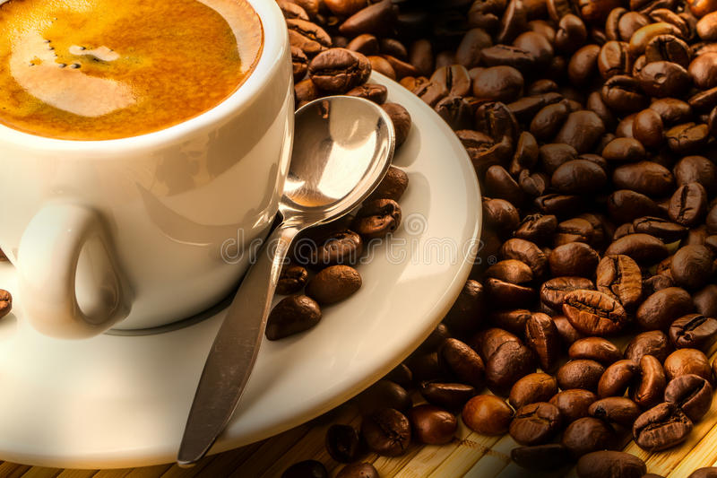 Coffee. Full coffee cup and coffee beans stock images