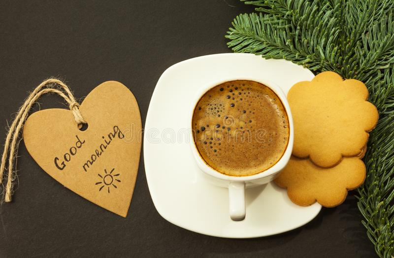 Coffee and ginger cookies on a dark table, good morning concept, top view royalty free stock photography