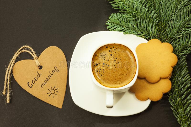 Coffee and gingerbread cookies on a dark table, good morning concept stock photos