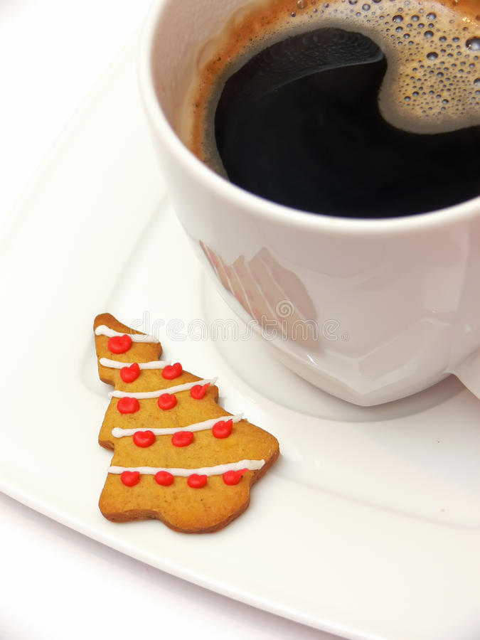 Coffee and gingerbread tree royalty free stock image