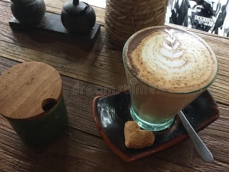 Coffee in glass. Heart cookie. Cafe latte art. royalty free stock photos