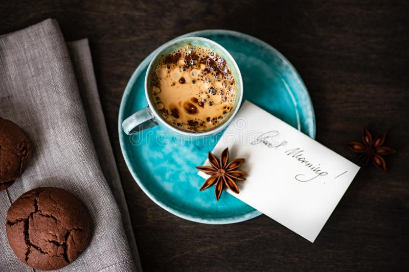 Coffee and good morning concept. Cup of coffee and good morning note on wooden background with copy space stock image