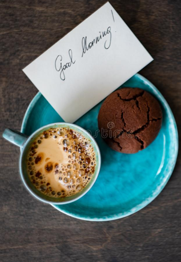 Coffee and good morning concept. Cup of coffee and good morning note on wooden background with copy space stock photos