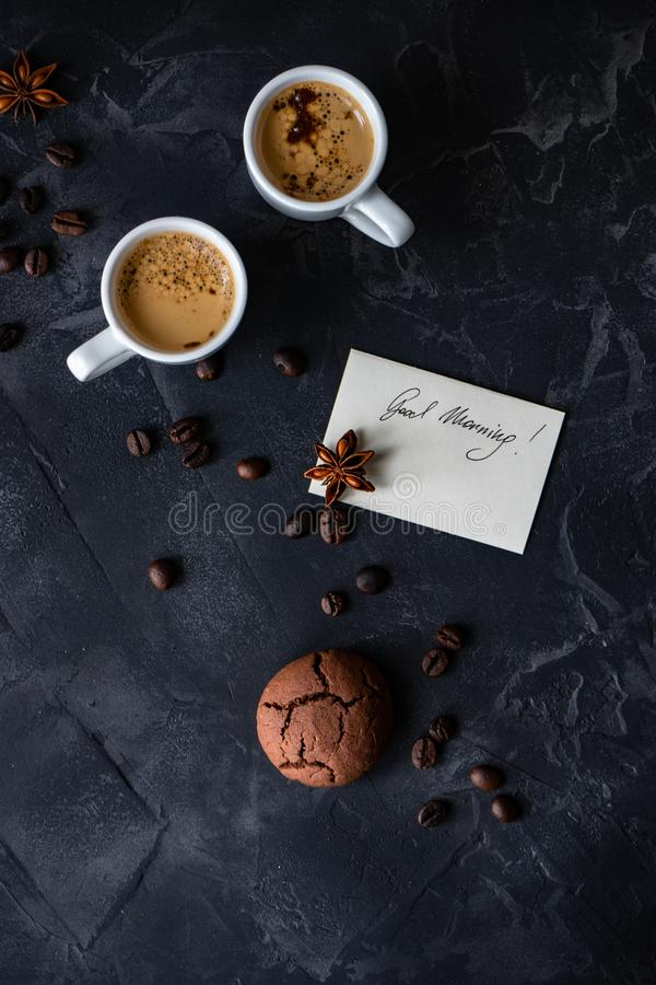 Coffee and good morning concept. Cup of coffee and good morning note on wooden background with copy space royalty free stock photo
