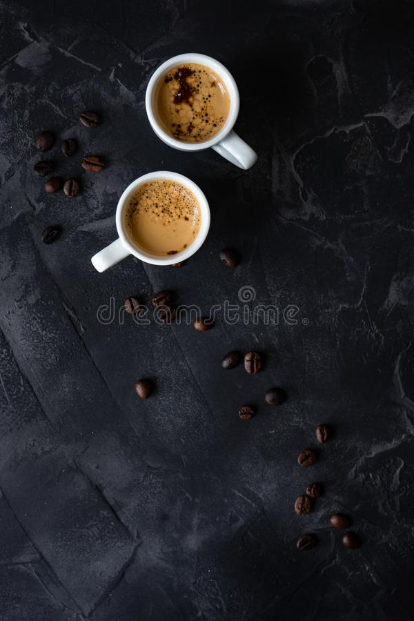 Coffee and good morning concept. Cup of coffee and good morning note on wooden background with copy space royalty free stock images