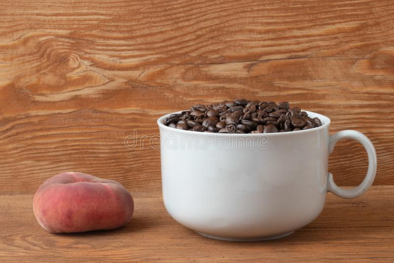 Coffee grains in a white cup stock photos