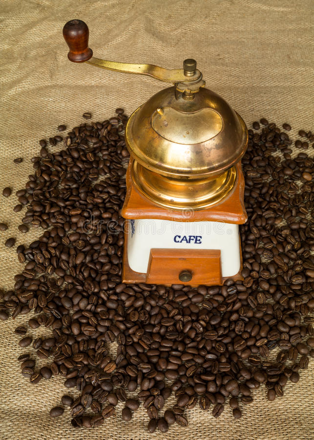 Coffee grinder and beans royalty free stock images