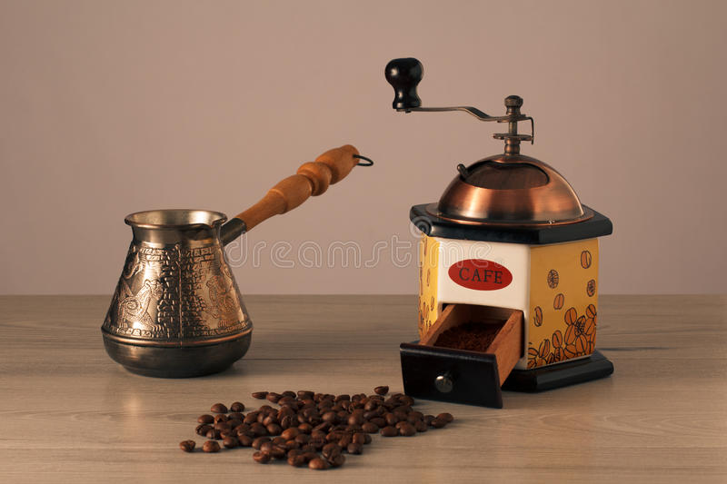 Coffee grinder, cezve and coffee beans royalty free stock photography
