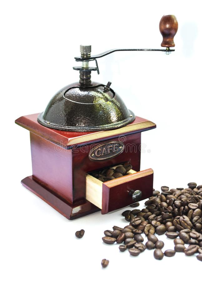 Coffee grinder and coffee beans on a white background stock photography
