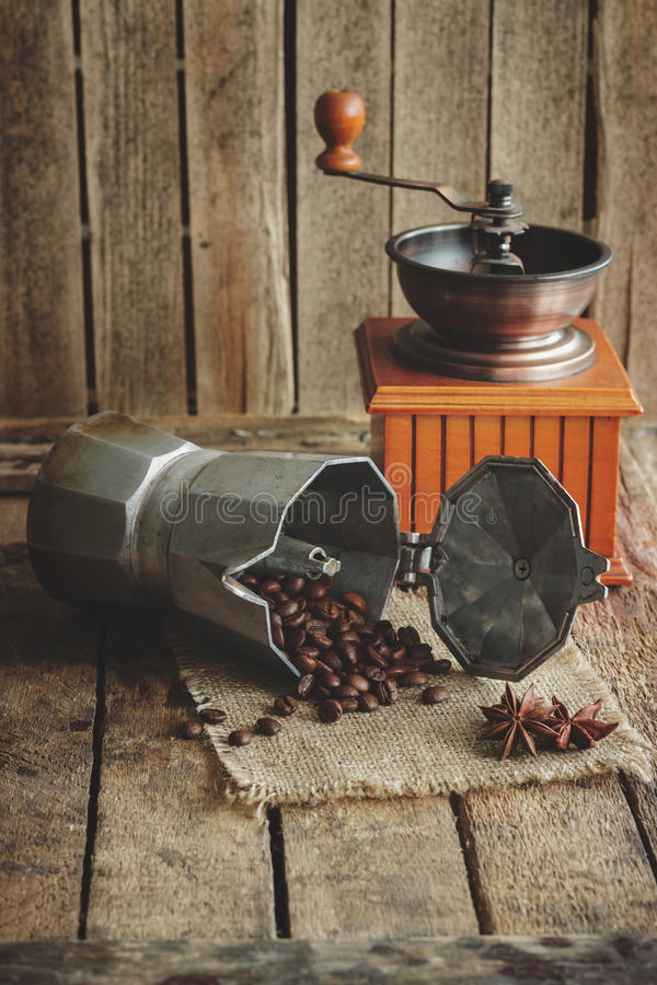 Coffee grinder, coffeepot and roasted coffee beans stock image