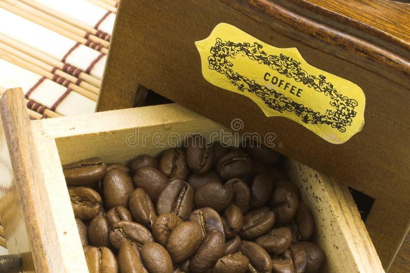 Coffee grinder drawer filled with coffee beans royalty free stock photo