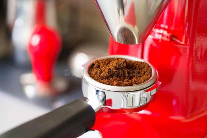 Coffee grinder grinding royalty free stock photos