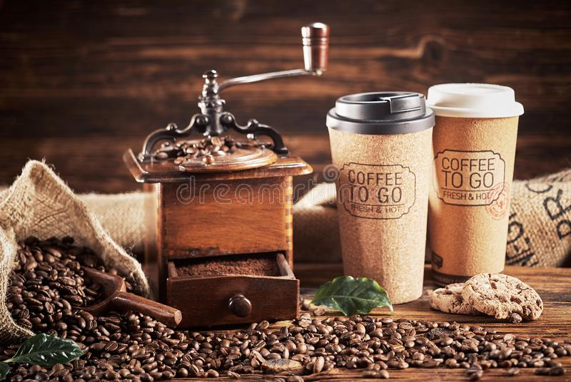 Coffee with grinder and Coffee To Go cups stock photo