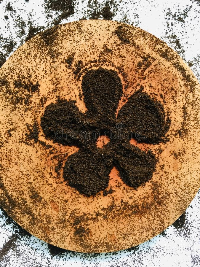 Coffee grounds art flowers wallpeper background royalty free stock photography