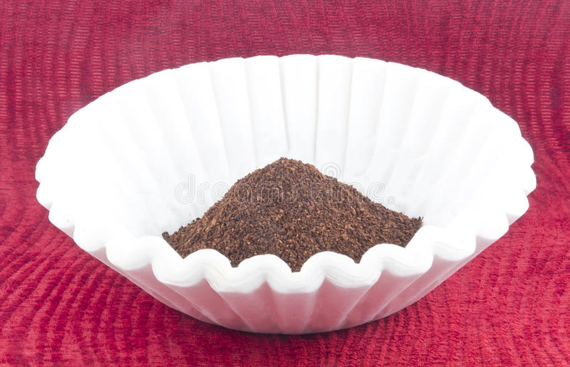 Coffee Grounds Filter. Fresh coffee grounds ready to be brewed for morning jolt of caffeine stock photography