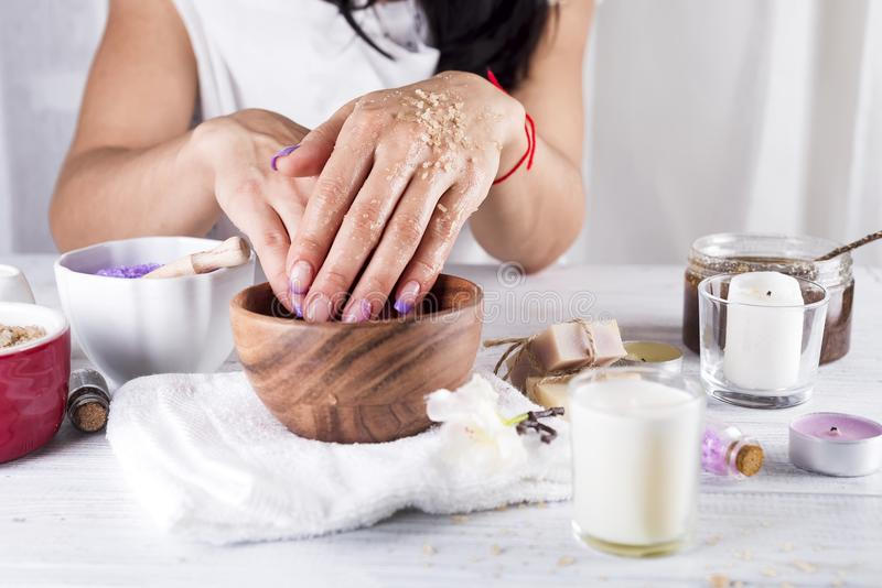 Young woman applies a coffee scrub on hands. Coffee hand scrub with ground coffee wet , mean to beauty or cosmetic, top view, copy space stock images