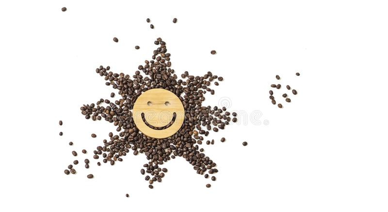 Coffee is a healthy, mood-enhancing drink. Star or sun from roasted coffee beans with a smile in the middle on a white. Coffee is a healthy, mood-enhancing drink royalty free stock photography