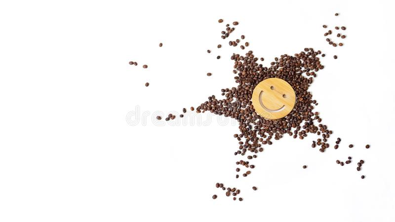 Coffee is a healthy, mood-enhancing drink. Star or sun from roasted coffee beans with a smile in the middle on a white. Coffee is a healthy, mood-enhancing drink stock images
