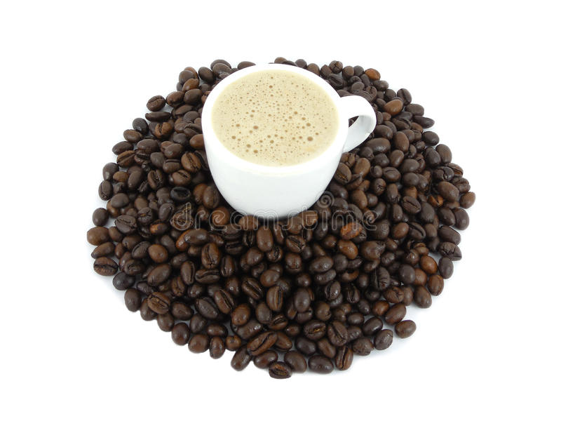 Coffee. On a heap of  beans stock images
