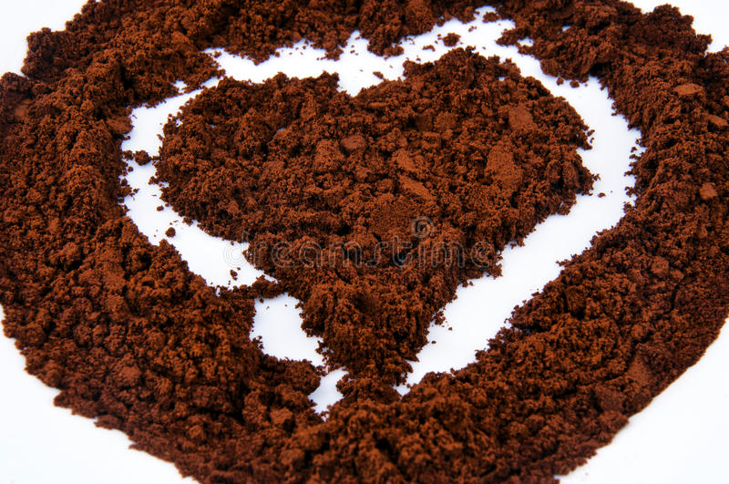 Coffee heart. Coffew draw heart on the white royalty free stock photo