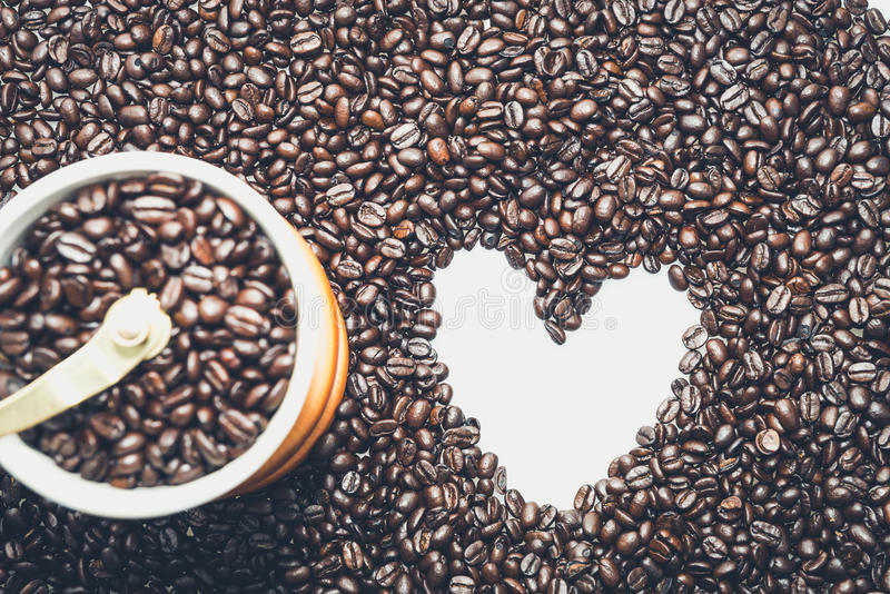 Coffee Heart. White heart symbol in coffee beans royalty free stock images
