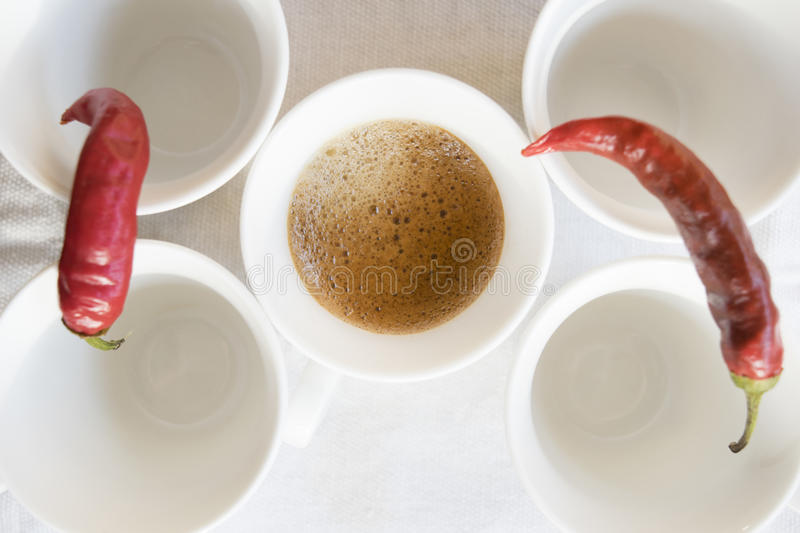 Coffee and hot peppers royalty free stock images