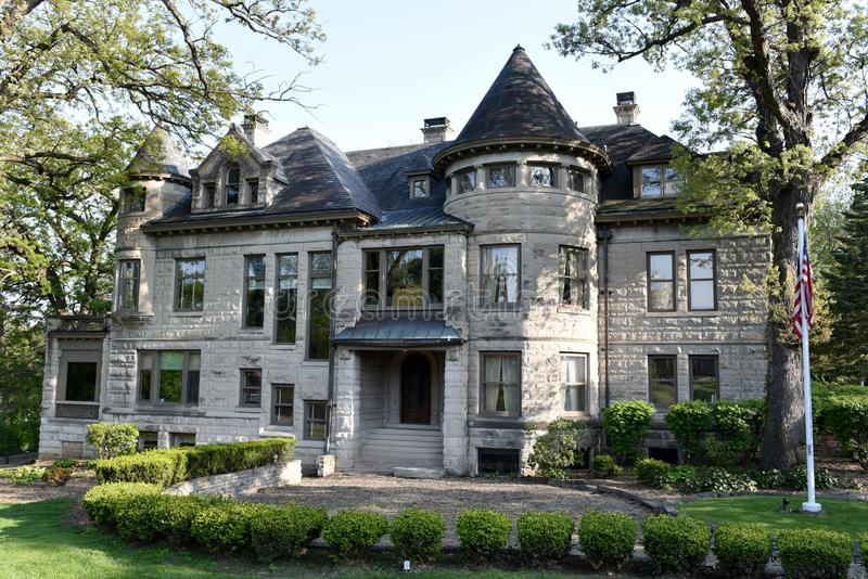 The Coffee House. This is a Spring picture of the W.O. Coffee Mansion located in Des Moines, Iowa. The mansion withtwofoot thick wall was built out of Gray Stone stock photos