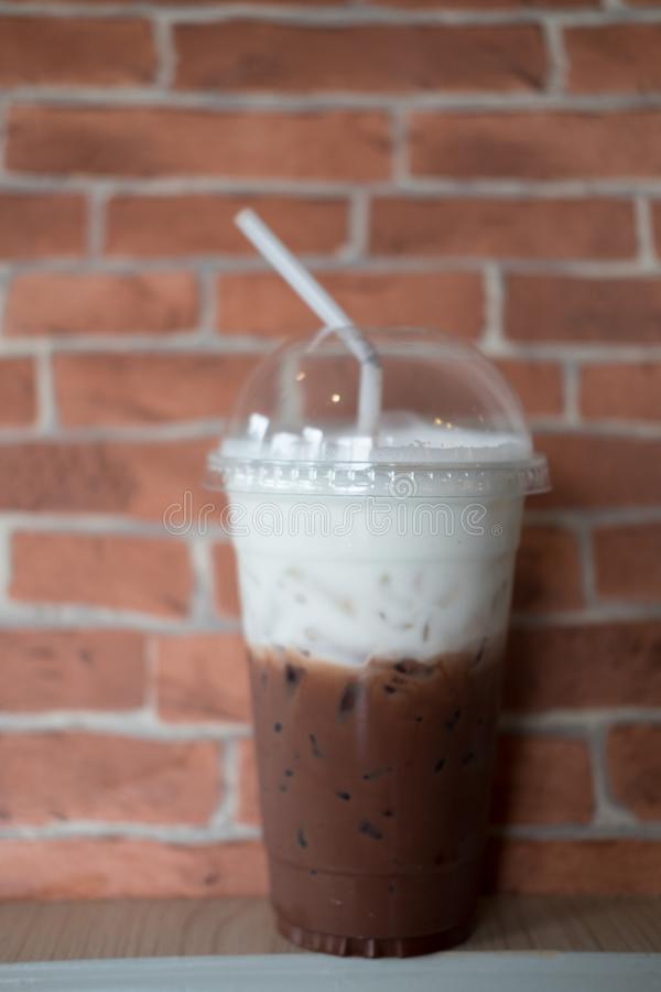 Coffee iced coffee mocha. With brick wall in cafe stock image
