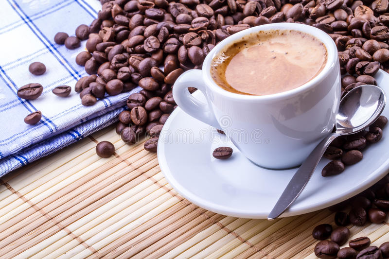 Coffee. Image of a cup of coffee on a bamboo mat, breakfast concept royalty free stock photos