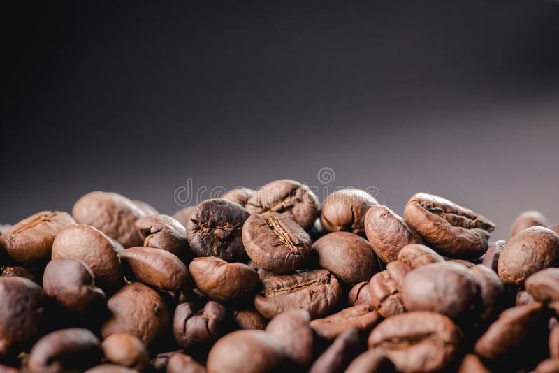 Coffee incup and coffee beans are the background. stock images