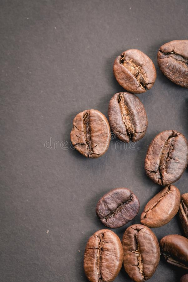 Coffee incup and coffee beans are the background. royalty free stock image